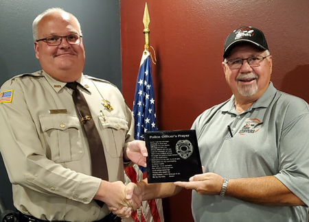 Brett Vetter receives his plaque from Crime Stoppers President Terry Woelfel