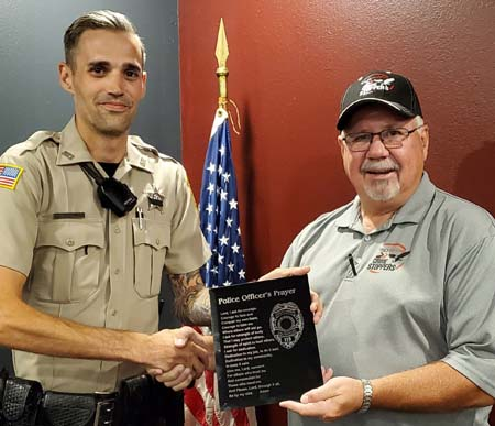 Zach Hardin receives his plaque from Crime Stopper's President Terry Woelfel