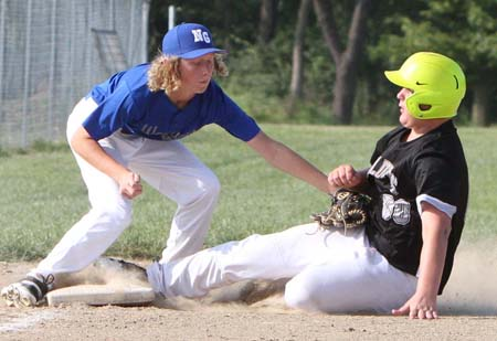 Owen Schutz applies the tag to West Central's Gabe Howard