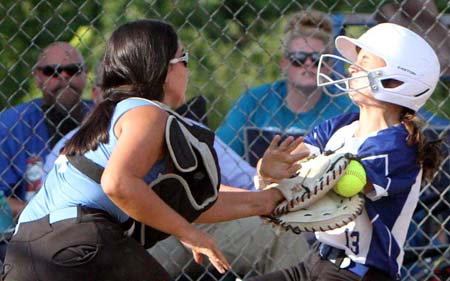 St. Francis' Lily Wilkinson applies the tag