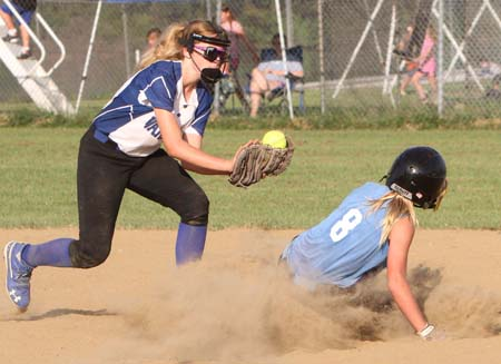 St. Francis' Anna Kribbs safely slides into second base
