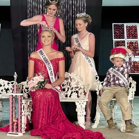 Photo courtesy of Bonnie Snyders The Calhoun County Fair wrapped up on Sunday, Sept. 12 with a crowning of a new queen Alexis Klocke by retiring queen Toni Zirkelbach, assisted by Jr. Miss Reagan Clendenny.