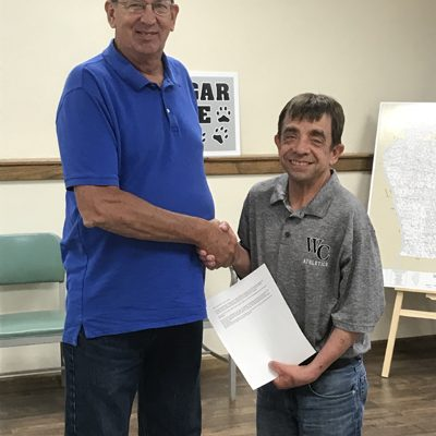 At Winchester's Wednesday, Sept. 1, city council meeting, Alderman Bill Jacquot officially congratulated Winchester resident Kent Coultas on being inducted into the Illinois Basketball Coaches Association (IBCA) Hall of Fame on behalf of Winchester's city government. (Submitted photo)
