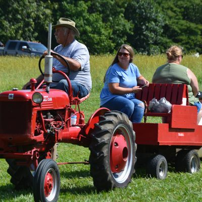 Kids (and even their diligent mothers) enjoyed barrel rides pulled by good old-fashioned American machinery, which took them all around the grounds. (Connor Ashlock/Jersey County Journal)